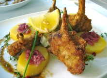 Fried Lamb Chops With Red Cabbage Potato Salad In Bressanone, Italy