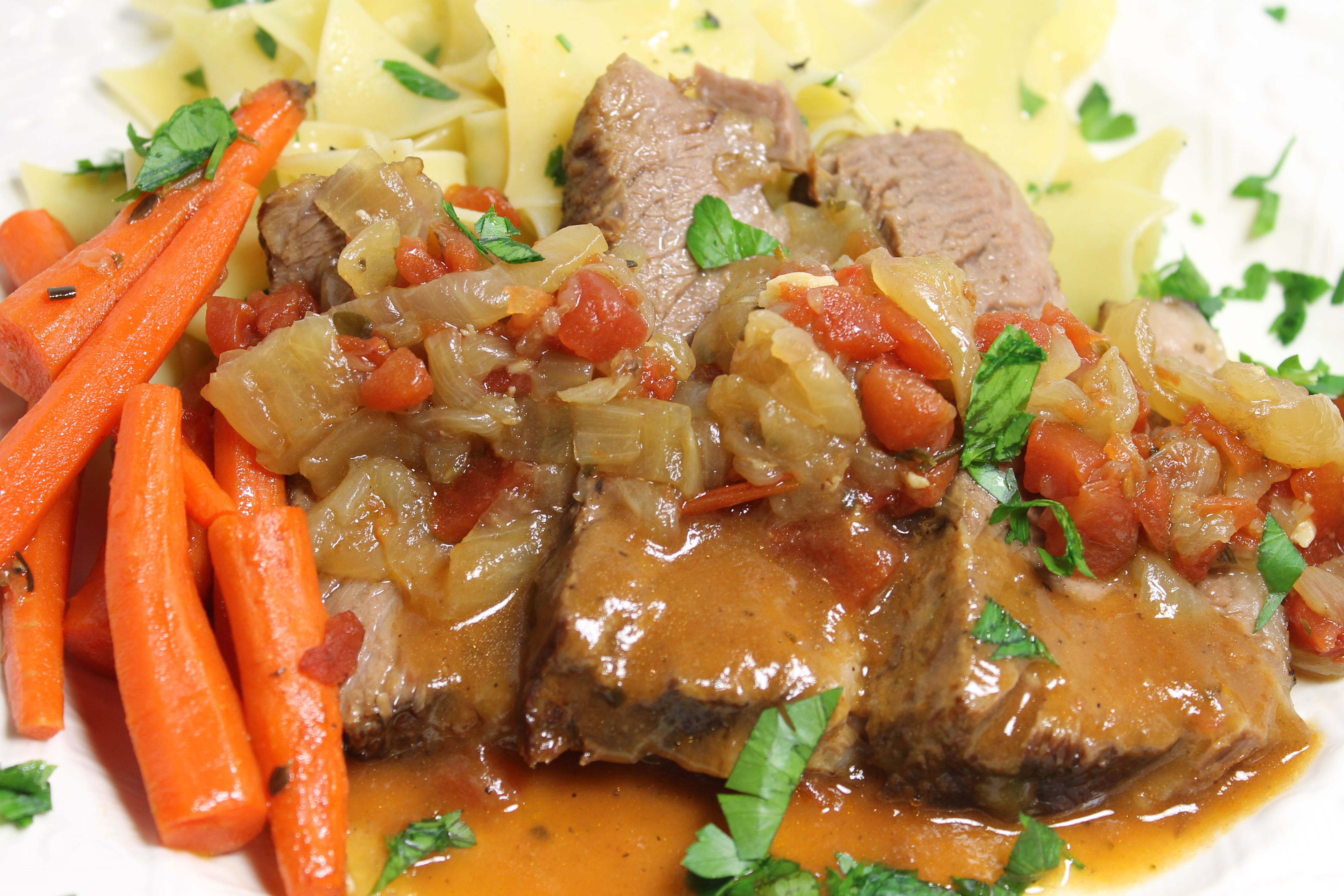 Slow Braised Beef Brisket Served With Roasted Baby Carrots And ...