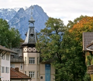 The Richard Strauss Institute With The Zugspitze Mountain Looming Large Behind