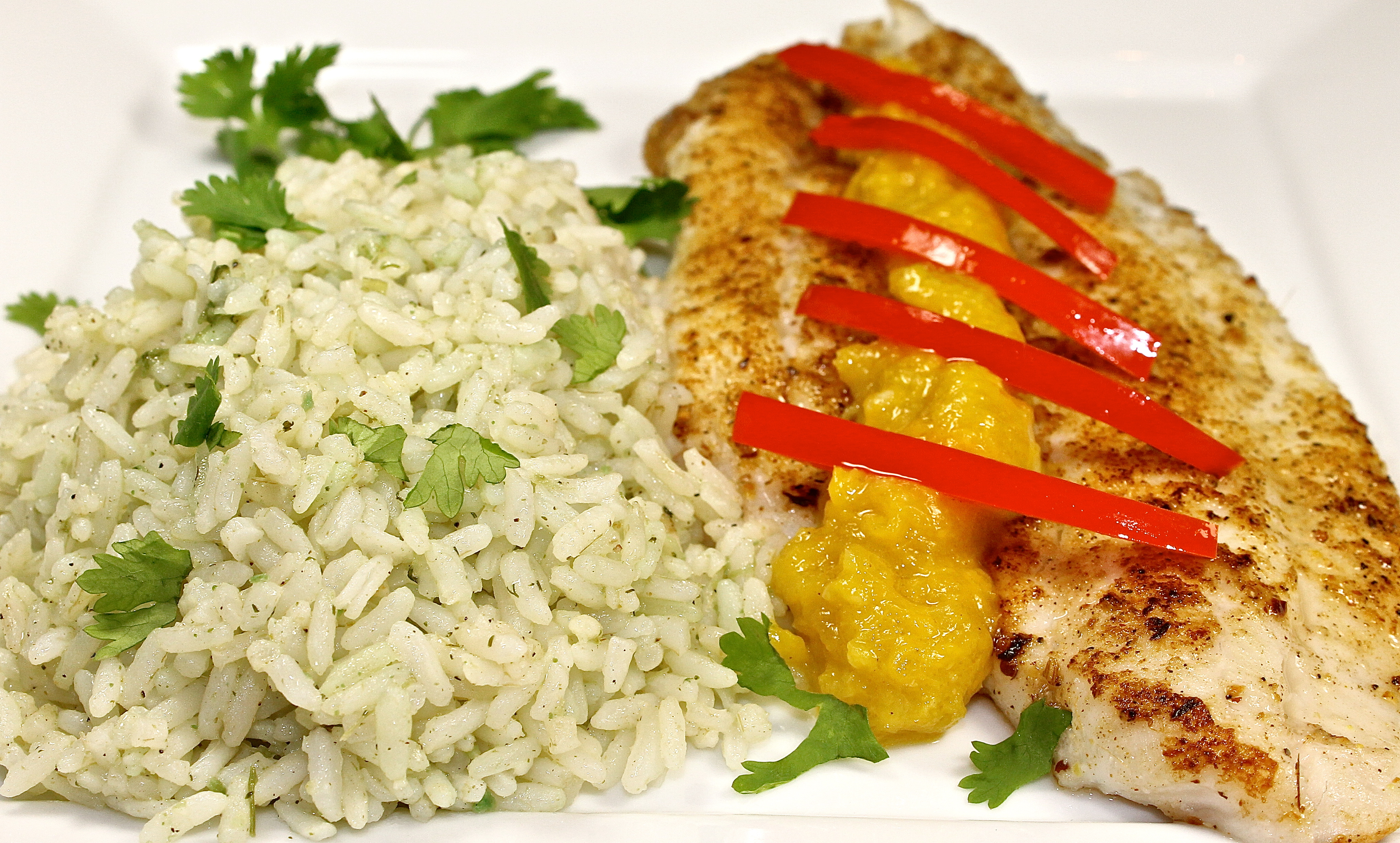 Jamaican jerk fish with mango sauce and green rice back for Rice dishes with fish