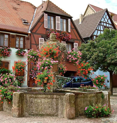 Town Fountain Full Of Flowers