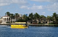 The Water Taxi Passes By Million Dollor Homes Lining The Waterway
