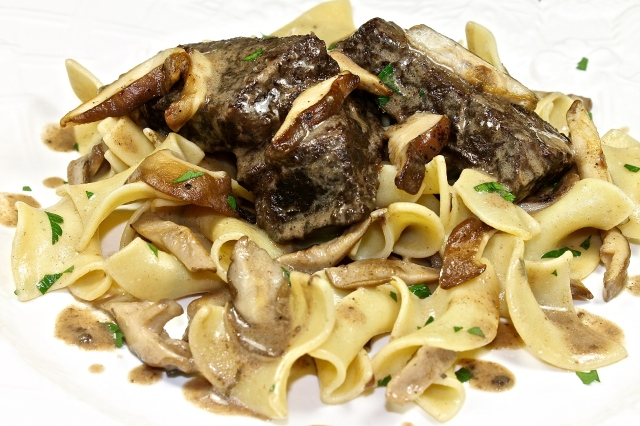 Braised Short Ribs With Wild Mushrooms Served Over Egg Noodles