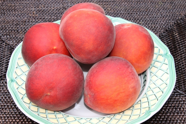A Bowl Of Fresh Peaches