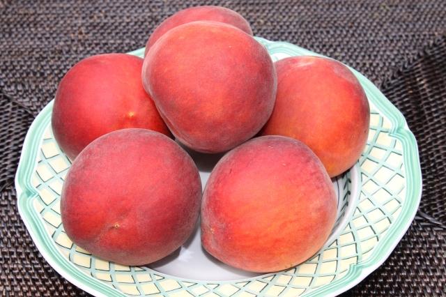 A Bowl Of Fresh Peaches