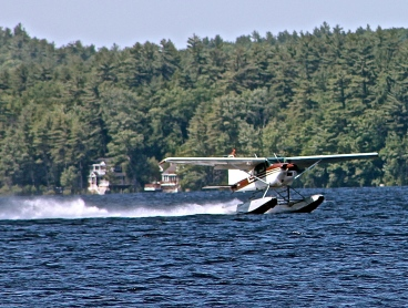 Seaplane Takes Off On Long Lake, Maine