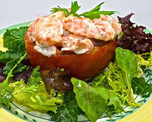 Black Krim Heirloom Tomato Stuffed With Lobster Salad On A Bed of Mixed Greens