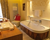Bathroom With Soaking Tub And A Leather Chair...Red Basket To Take Your Necessities To The Spa