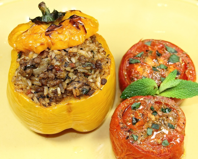 Peppers With A Lamb And Rice Stuffing Served With Oven Roasted Tomatoes