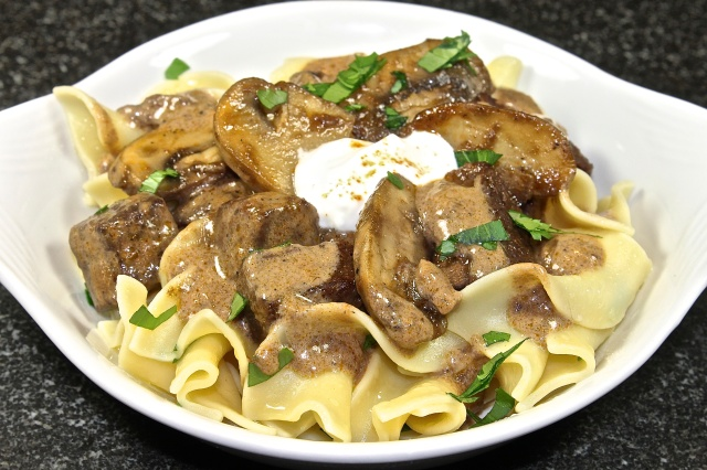 Braised Beef Stroganoff Served Over Buttered Noodles