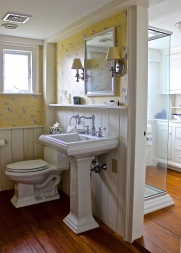 New England Style Guest Bathroom Is Divided Into Two Separate Parts