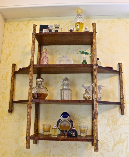 Antique Bamboo Selves Displaying Perfume Bottles