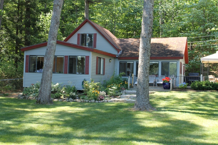 The Waterfront Lawn Of The Cottage Has Been Professionally Landscaped