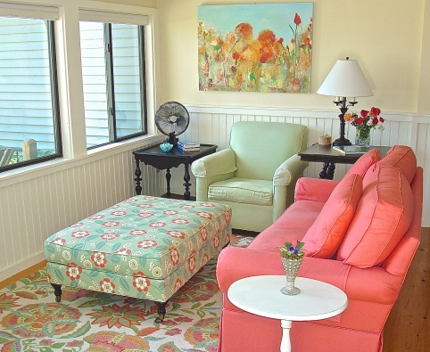 The Colorful Family Room Is Decorated With A Mixture of Old And New