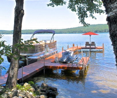 Pontoon Boat And Jet Ski For Summer Fun On The Lake