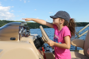 Just Tall Enough…Our Granddaughter's First Time Of Running The Boat With Papas Guidance