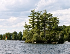 Boating Past One Of The Islands In Long Lake