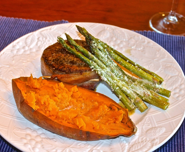 Pan Seared Bacon Wrapped Filet Mignon With A Baked Sweet Potato And Parmesan Crusted Asparagus