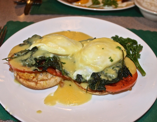 Florentine Eggs Benedict With Grilled Tomatoes, Sautéed Spinach And Hollandaise Sauce