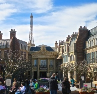 Eiffel Tower Over The Rooftops Of Paris In Epcot's France
