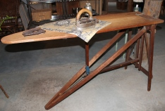 Old Wooden Ironing Board With Antique Gasoline Heated Iron
