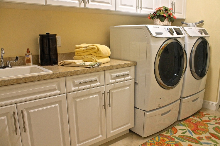 The Washer And Dryer On Pedestals With Drawers To Hold Washing Essentials