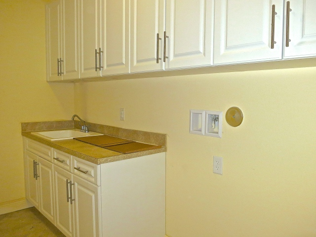 Basic Laundry Room With Optional Tall Upper Cabinets And Deep Sink