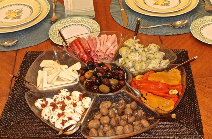 Classic Italian Antipasto Of Marinated Vegetables, Meats And Cheeses