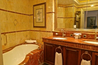 Marble Bathroom With Large Tube And Walkin Shower