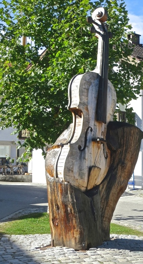 Large Violin Carved Out Of A Tree Trunk