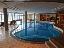 The Indoor Pool Is Connected To The Outdoor Pool
