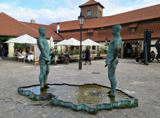 "Controversial Cerny Sculpture ""Piss"" Outside Kafka Museum"