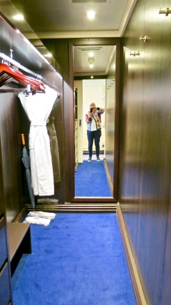 The Walk In Closet With Plenty of Hanging Space, Drawers And Safe