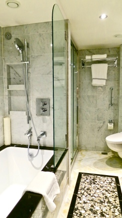 A Full Sized Tub And Large Walk In Shower