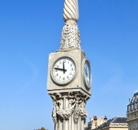 One Of The Clocks In Place de la Comedie