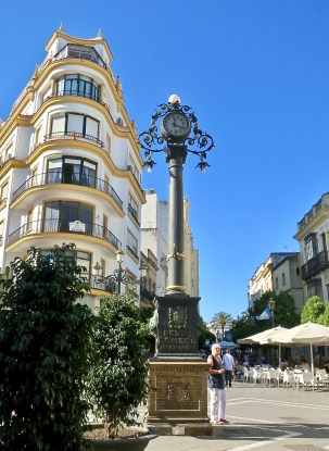 Pedro Domecq Clock in Front Of Wedge Shaped Building in Center Of Town