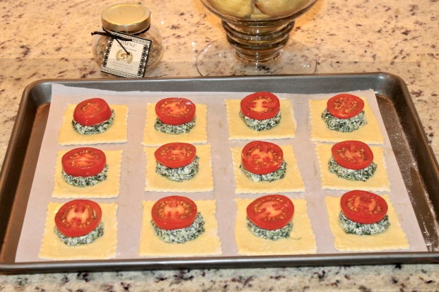 preparing tomato spinach and goat cheese tart