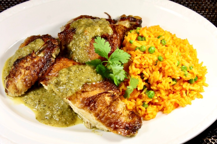 roast chicken topped with green mole