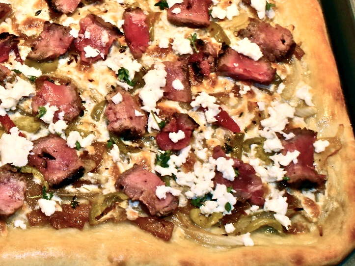 steak pizza with caramelized onions and gorgonzola cheese