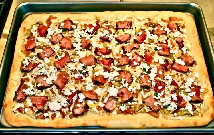 steak pizza with caramelized onion and gorgonzola