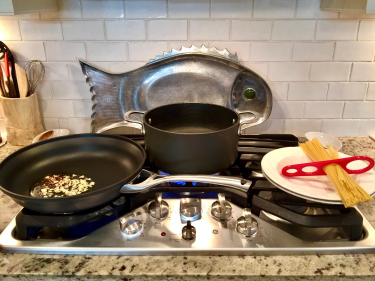 preparing pasta puttanesca